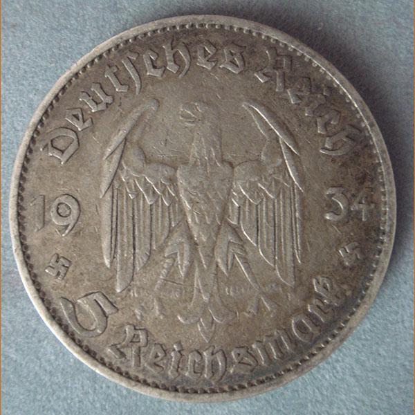 Немецкие монеты 1934 года цена монетап 50 копеек 1957 г стоимость